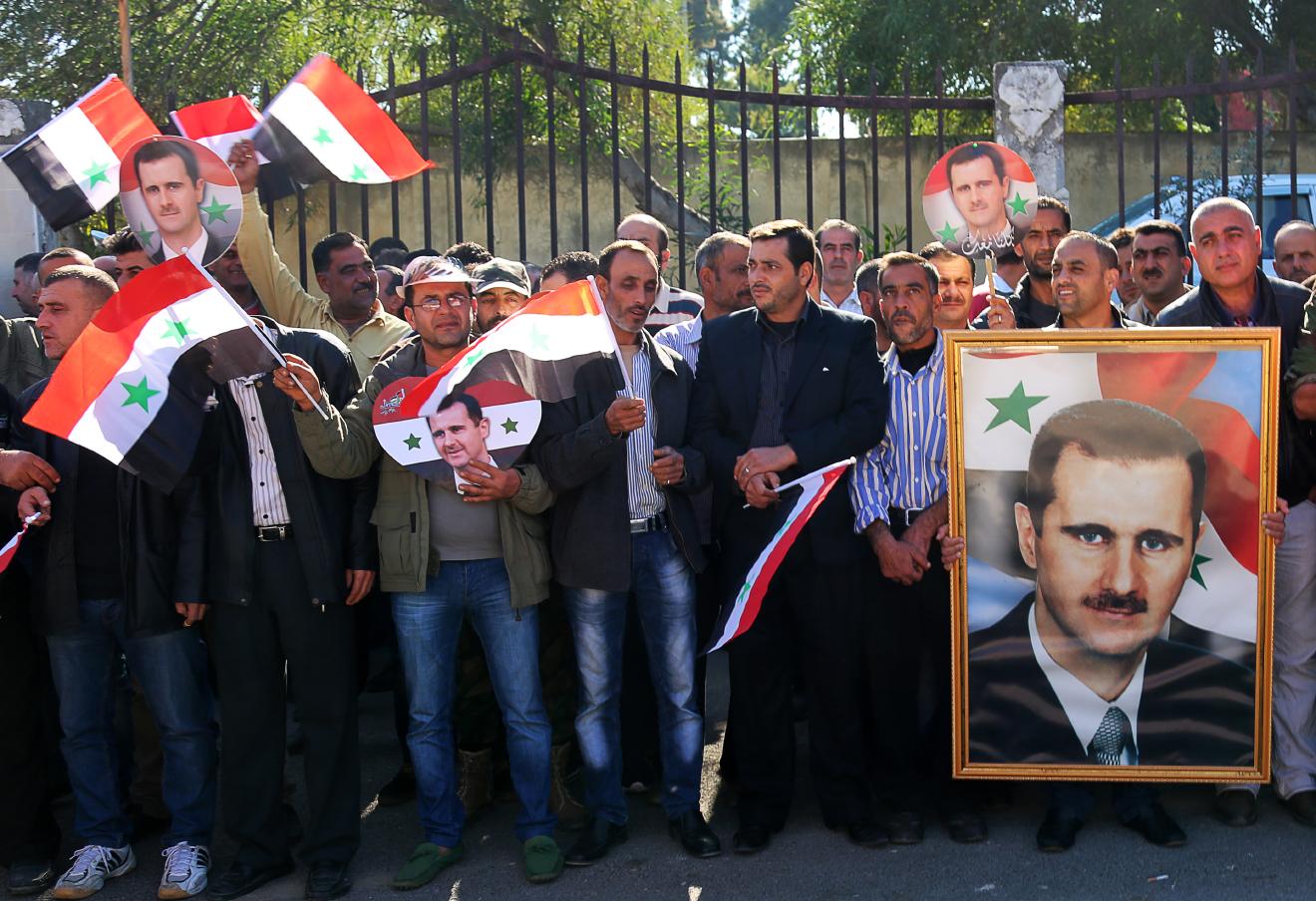Церемония выпуска отрядов народной самообороны Сирии в провинции Латакия.