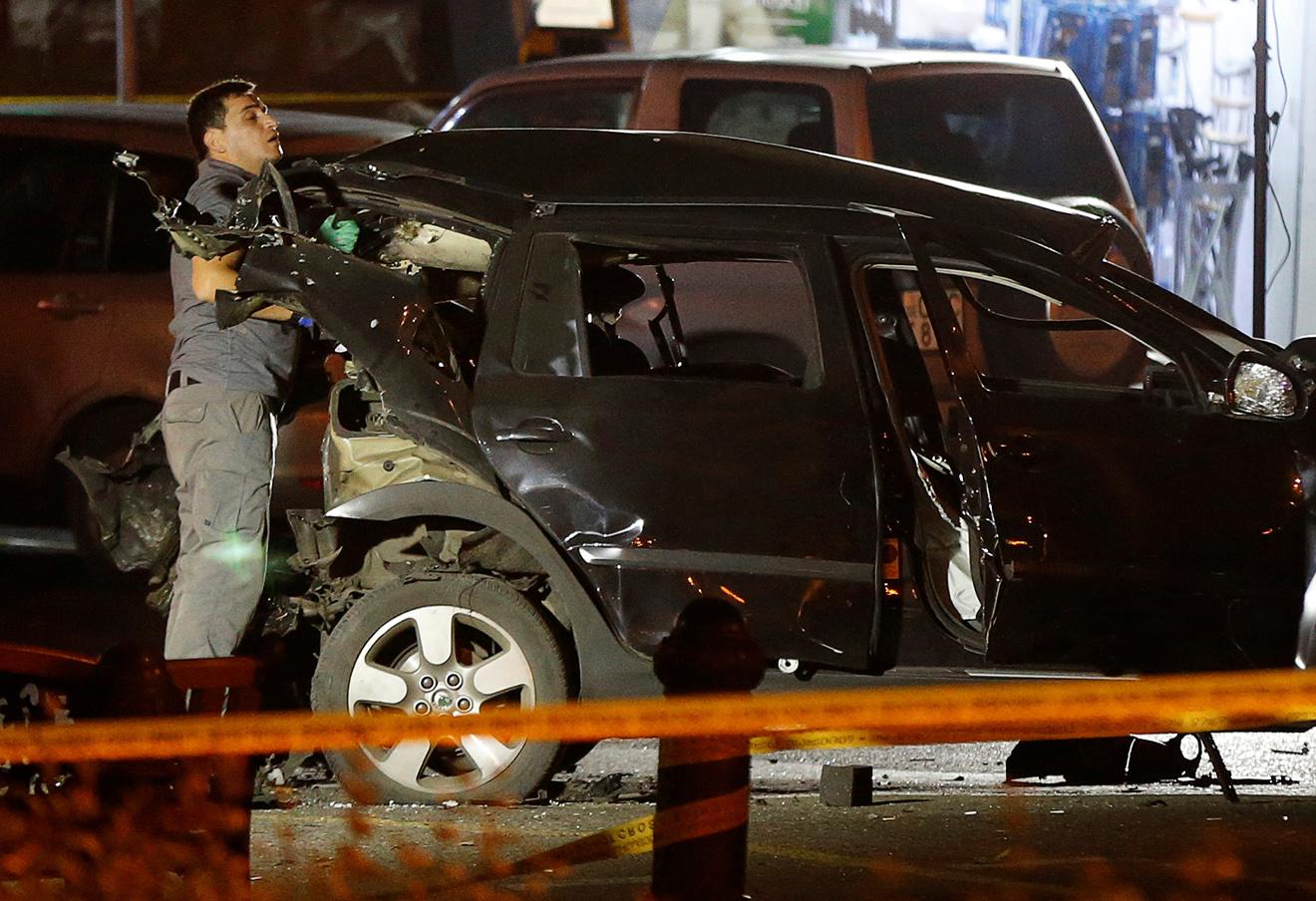 Автомобиль Гиви Таргамадзе после взрыва, Тбилиси, 4 октября 2016 года. Фото: David Mdzinarishvili / Reuters