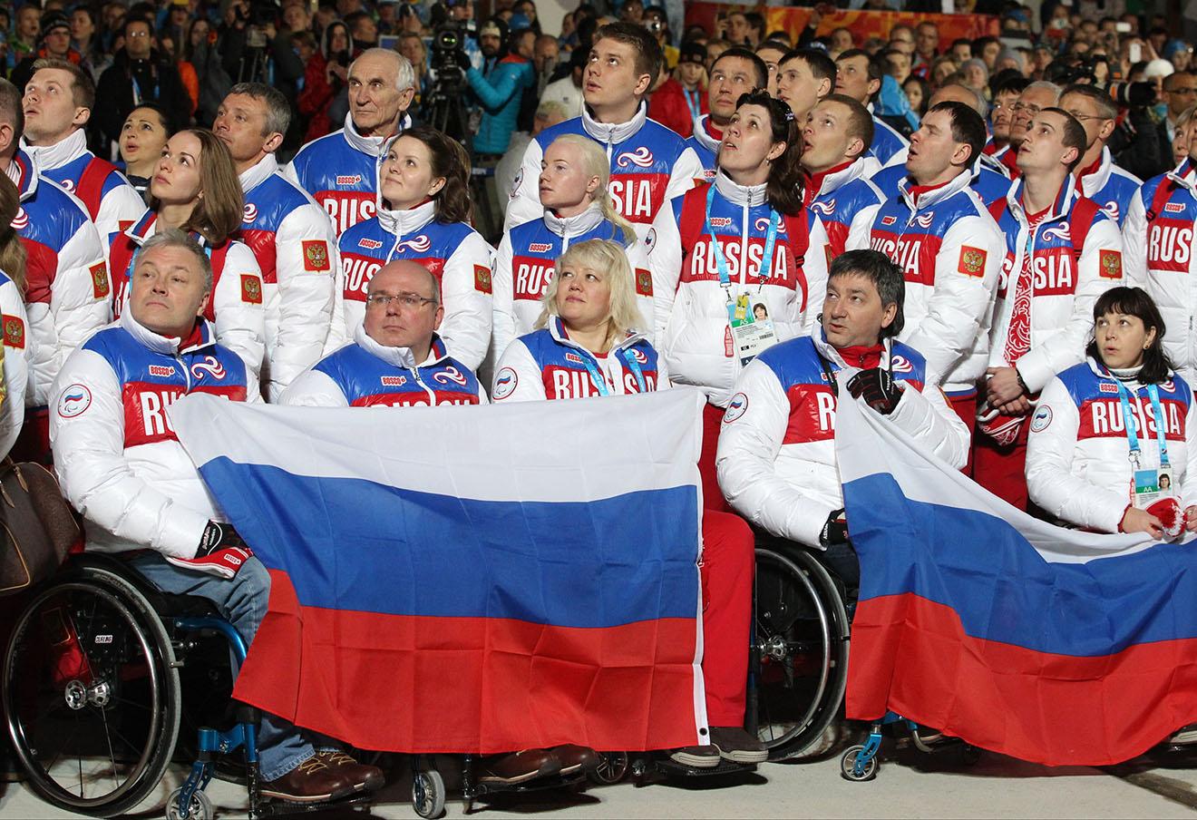 Во время церемония поднятия флага паралимпийской Сборной России в Сочи, 2014 год. Фото: Юрий Самолыго / ТАСС