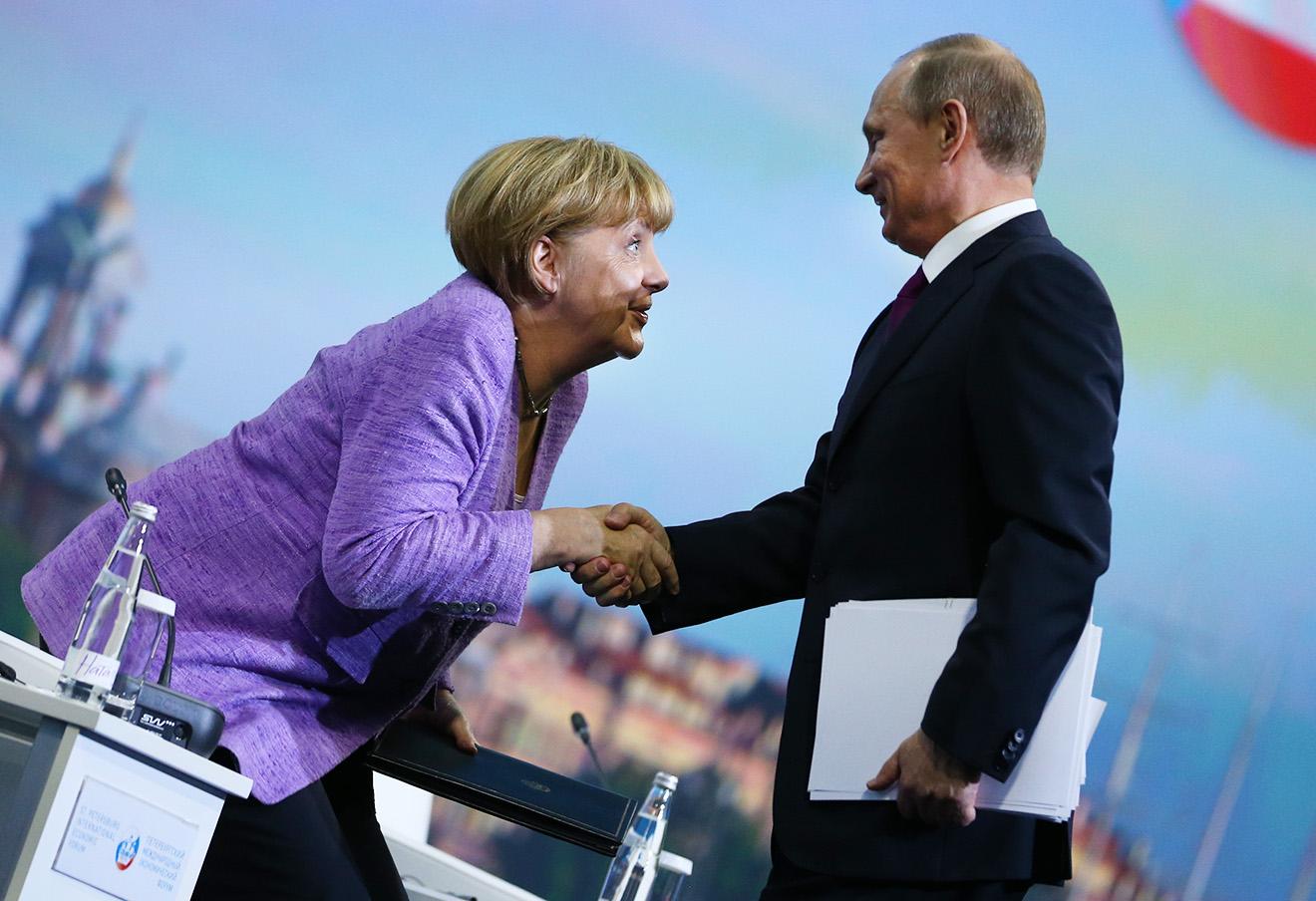 Ангела Меркель и Владимир Путин.