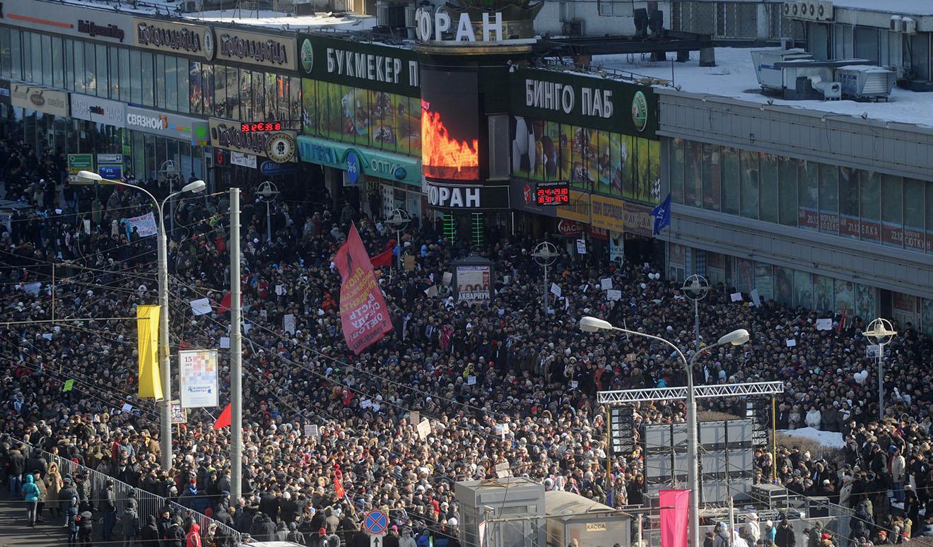 Во время митинга «За честные выборы» на улице Новый Арбат, 10 марта 2012 года.