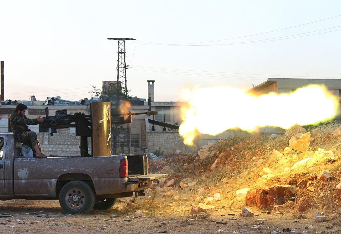 Повстанцы атакуют силы режима Асада. Сирия, Алеппо, 10 июля 2016. Фото: Mustafa Sultan / AFP