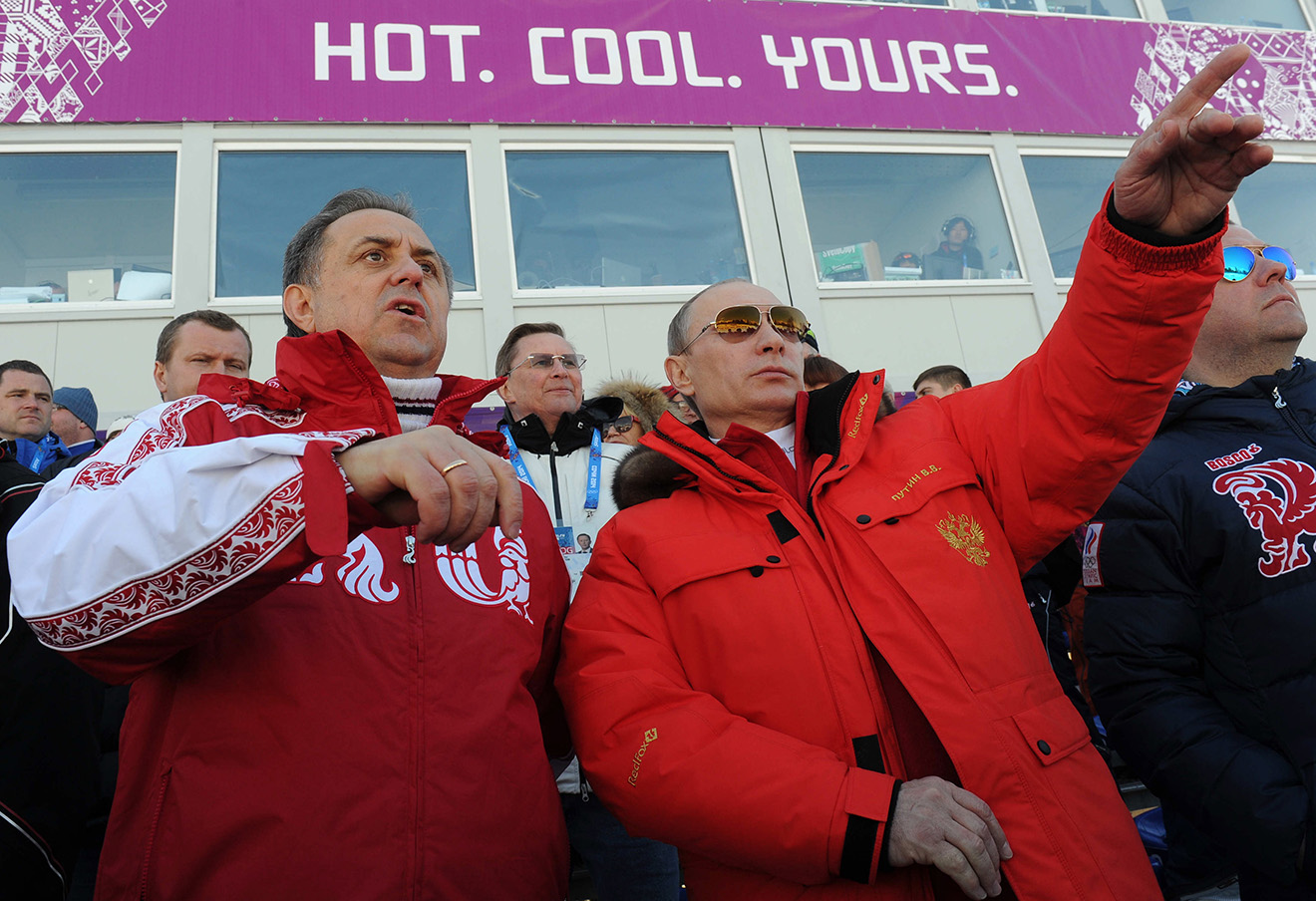 Виталий Мутко и Владимир Путин на мужской эстафете в соревнованиях по лыжным гонкам на XXII Зимних Олимпийских играх.
